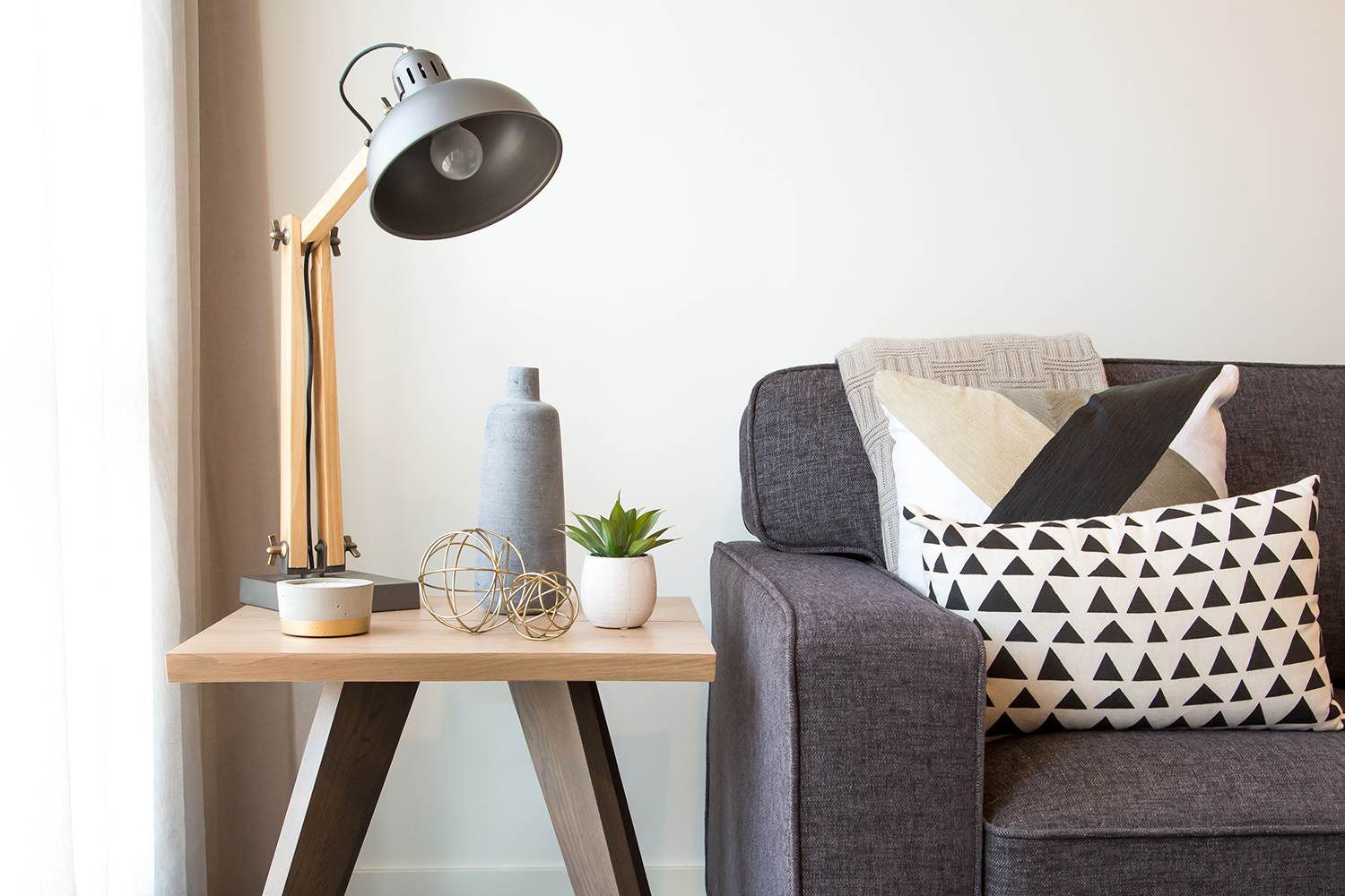 How-To-Create-Scandinavian-Style-In-Your-Home - Rustic-industrial-side-table-with-couch